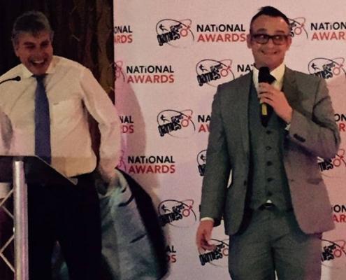 on stage-magic-magician in london-wimbledon-John Inverdale-coke cola-charity